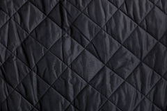 Fondo acolchado negro de la tela Fotos de archivo libres de regalías