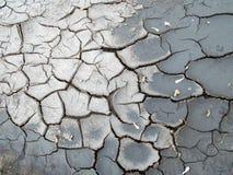 Fondo agrietado de la tierra Modelo agrietado del fango Fotografía de archivo libre de regalías