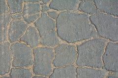 Fondo agrietado gris del asfalto Fotos de archivo libres de regalías