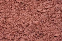 Fondo al suolo rosso Fotografie Stock