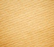 Fondo amarillento de la textura de la cartulina acanalada. Imágenes de archivo libres de regalías