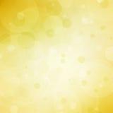 Fondo amarillo abstracto con las luces de la burbuja del bokeh y el copyspace de centro blanco