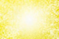 Fondo amarillo abstracto de la falta de definición - CCB ligero hermoso del bokeh del oro fotografía de archivo