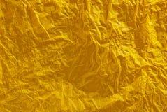 Fondo amarillo arrugado de papel de tejido Fotografía de archivo
