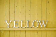 Fondo amarillo de la palabra del color Imagenes de archivo