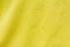 Fondo amarillo de la tela Foto de archivo libre de regalías