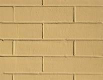 Fondo amarillo de la textura de la pared del ladrillo Imagenes de archivo