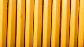 Fondo amarillo del lápiz de la escuela Imágenes de archivo libres de regalías