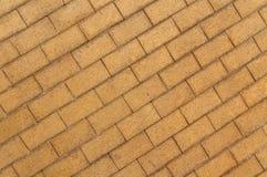 Fondo amarillo gris del pavimento de la piedra del adoquín Imagenes de archivo