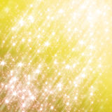 Fondo amarillo que brilla con las estrellas Foto de archivo