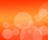 Fondo anaranjado abstracto con la tarjeta de las partículas .holiday Fotos de archivo libres de regalías