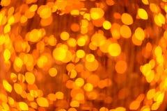 Fondo anaranjado de la luz del extracto del bokeh Fotografía de archivo