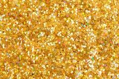 Fondo anaranjado de la Navidad de la textura del brillo Brillo de oro brillante fotos de archivo libres de regalías