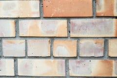 Fondo anaranjado de la pared de ladrillo Fotografía de archivo libre de regalías