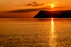 Fondo anaranjado de la puesta del sol Foto de archivo