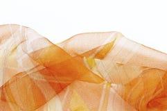 Fondo anaranjado de seda colorido de las bufandas Foto de archivo libre de regalías