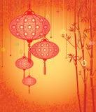 Fondo anaranjado del linterna y de bambú Fotos de archivo libres de regalías