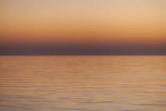 Fondo anaranjado liso de la puesta del sol del mar Imagen de archivo libre de regalías