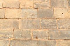 Fondo antiguo de la calzada de la pared de piedra imagenes de archivo