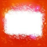 Fondo arancio caldo con l'insegna magica della neve Fotografie Stock Libere da Diritti