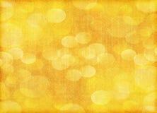 Fondo arancio della carta del bokeh di festa Immagine Stock