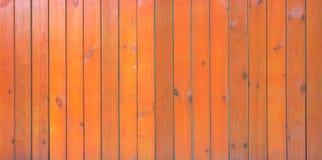Fondo arancio di superficie di legno Immagini Stock