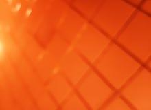 Fondo arancio diagonale del bokeh di griglia Fotografie Stock