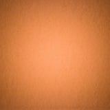 Fondo arancio pastello di struttura della carta di colore Fotografie Stock