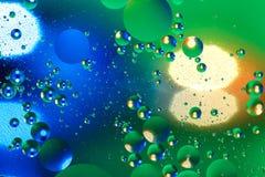 Fondo artificial colorido con las burbujas Foto de archivo libre de regalías