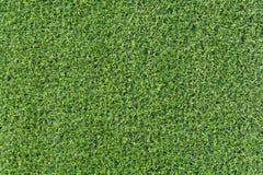 Fondo artificial de la hierba verde de la echada del fútbol imagen de archivo libre de regalías