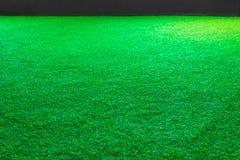 Fondo artificial de la textura de la hierba verde o del campo de deporte imagenes de archivo