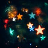 Fondo astratto con Bokeh nella forma delle stelle Immagini Stock