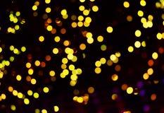 Fondo astratto con le luci e le stelle del bokeh Immagini Stock