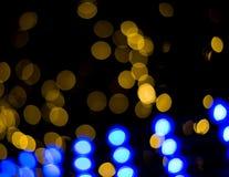 Fondo astratto con le luci e le stelle del bokeh Fotografie Stock Libere da Diritti