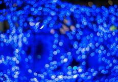 Fondo astratto con le luci e le stelle del bokeh Fotografia Stock