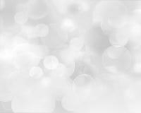 Fondo astratto d'argento leggero con i fiocchi di neve bianchi Fotografie Stock Libere da Diritti