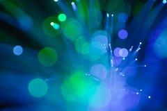 Fondo astratto degli indicatori luminosi blu e verdi del punto Fotografie Stock