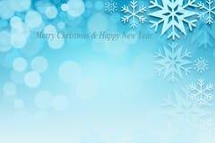 Fondo astratto del bokeh di Natale con i fiocchi di neve Immagini Stock