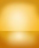Fondo astratto dell'oro con la pendenza Immagini Stock