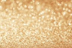 Fondo astratto dell'oro di scintillio Fotografia Stock