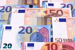 Fondo astratto di euro dei soldi denominazioni differenti delle banconote Fotografia Stock