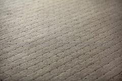 Fondo astratto - foto bassa di profondità di campo - tappeto con fotografia stock libera da diritti