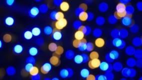 Fondo astratto illuminato luce blu della sfuocatura immagini stock libere da diritti