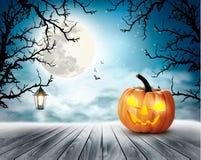 Fondo asustadizo de Halloween con la calabaza y la luna Fotografía de archivo