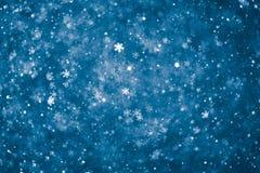 Fondo azul abstracto de los copos de nieve Fotografía de archivo libre de regalías
