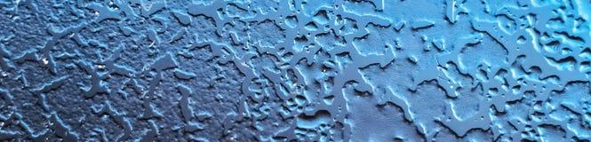 Fondo azul abstracto del panorama con textura del hielo sobre el vidrio fotografía de archivo