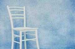Fondo azul abstracto del vintage con la silla Imagen de archivo libre de regalías