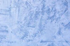 Fondo azul abstracto Textura de la pared enyesada desigual Masilla con las manchas y la aspereza La base para la disposici?n fotos de archivo libres de regalías