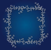 Fondo azul con el marco floral Foto de archivo libre de regalías