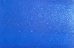 Fondo azul con las chispas Imagen de archivo libre de regalías